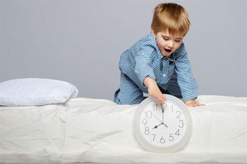 Child winding back clock